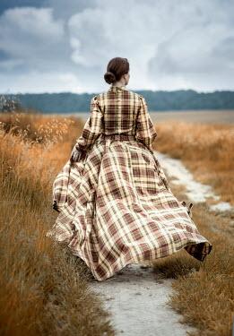 Jaroslaw Blaminsky WOMAN IN TARTAN GOWN WALKING IN COUNTRYSIDE Women