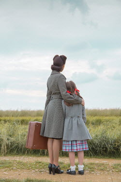 Joanna Czogala MOTHER AND DAUGHTER WITH SUITCASE IN COUNTRYSIDE Children