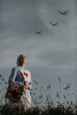 Magdalena Russocka historical wartime nurse looking at planes