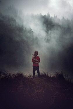 Nic Skerten BLONDE GIRL IN LANDSCAPE WITH FOGGY FOREST Women