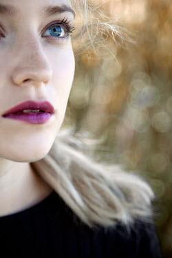 Miguel Sobreira Woman in Black Top Looking Up Eye Detail