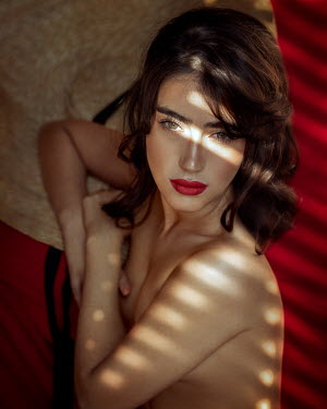 Anna Volynskaia Topless woman with red lipstick lying on bed