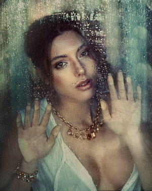 Anna Volynskaia Young woman behind wet window
