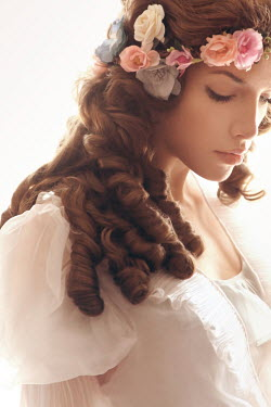 ILINA SIMEONOVA Young woman with curly hair and flower crown