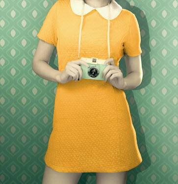 ILINA SIMEONOVA 1960s young woman in yellow dress with camera