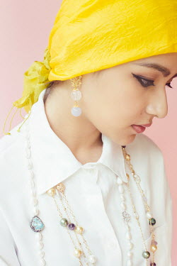 Jessica Lia Young woman in yellow headscarf