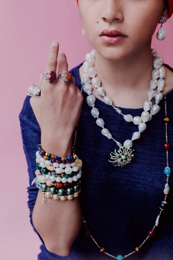Lalita Young woman with necklaces, bracelets, and rings