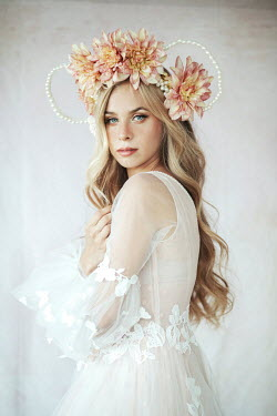 Jovana Rikalo Young woman in white dress with flower crown