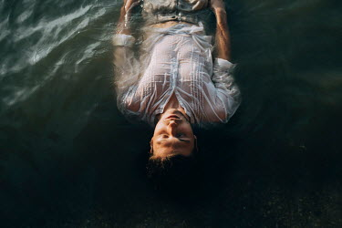 Jovana Rikalo Young man floating in lake