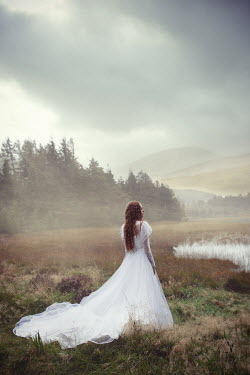 Natasza Fiedotjew Redhead girl in white eerie dress by lake