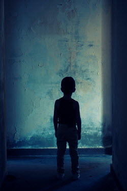 Mohamad Itani Silhouette of boy in corridor of abandoned house