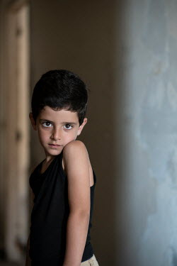 Mohamad Itani Boy in black tank top