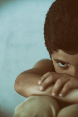 Mohamad Itani Boy staring while sitting