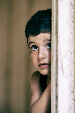 Mohamad Itani Boy in doorway of abandoned house