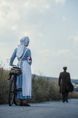 Magdalena Russocka wartime soldier and nurse with bike in countryside