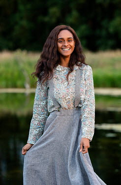 Rekha Garton Smiling young woman in field