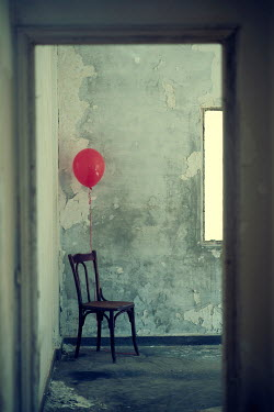 Mohamad Itani Chair with red balloon in abandoned house
