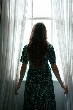 Miguel Sobreira Woman Standing at Window Silhouetted