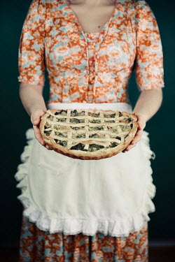 Natasza Fiedotjew Vintage woman offering pie