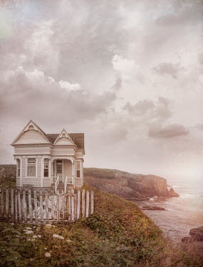 Jill Battaglia Victorian house on cliff by sea