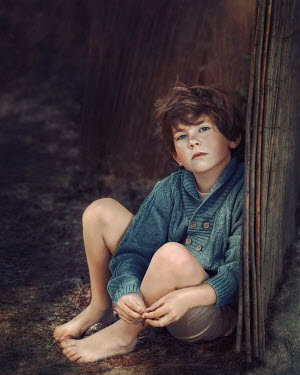 Anna Volynskaia Boy sitting by bamboo fence