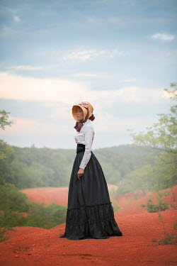 Ildiko Neer Victorian woman standing countryside