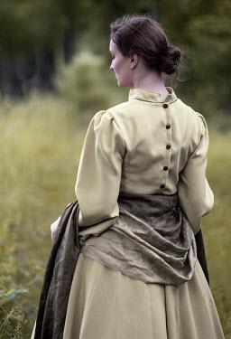 Jaroslaw Blaminsky Young woman in Victorian dress