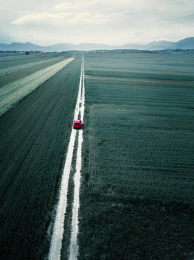 Magdalena Russocka red car on countryroad from above