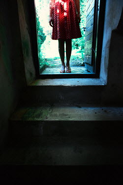 Magdalena Russocka young woman entering basement
