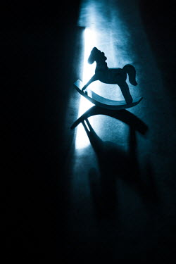 Magdalena Russocka shadowed rocking horse toy standing on floor