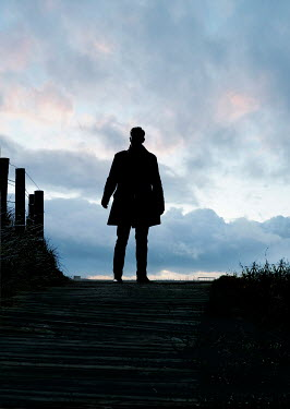 CollaborationJS SILHOUETTED MAN ON COASTAL PATH AT DUSK Men