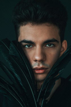 Jovana Rikalo FACE OF MAN WITH DARK HAIR AND FEATHERS Men