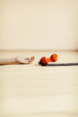Krasimira Petrova Shishkova FEMALE HAND LYING ON FLOOR WITH TELEPHONE RECEIVER Women