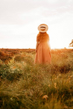 Shelley Richmond WOMAN WITH RED HAIR AND HAT IN SUNLIT COUNTRYSIDE Women