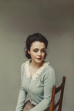 Shelley Richmond WOMAN IN LACY CARDIGAN SITTING ON CHAIR Women