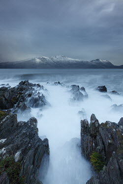 David Baker MISTY SEA AND ROCKS WITH SNOWY COASTLINE Seascapes/Beaches