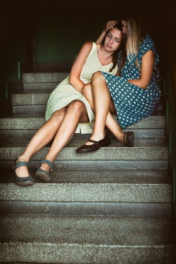 Svetoslava Madarova TWO WOMEN SITTING ON CONCRETE STEPS Women