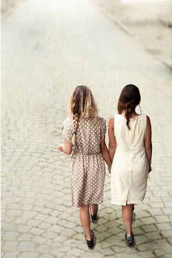Svetoslava Madarova TWO GIRLS HOLDING HANDS ON COBBLED STREET Women