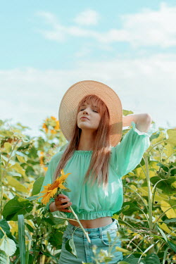 Tijana Moraca GIRL IN JEANS AND HAT IN SUNFLOWER FIELD Women