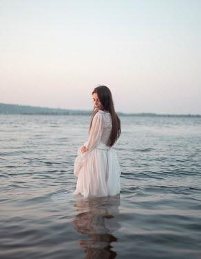 Inna Mosina WOMAN IN WHITE DRESS STANDING IN WATER Women