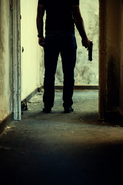 Mohamad Itani MAN STANDING IN DERELICT BUILDING WITH GUN Men