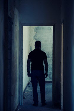Mohamad Itani MAN STANDING IN DERELICT BUILDING IN SHADOW Men