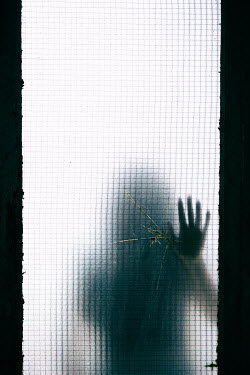 Mohamad Itani SHADOW OF WOMAN TOUCHING BROKEN WINDOW Women