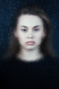 Magdalena Russocka young woman behind frosted glass