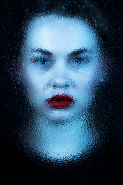 Magdalena Russocka young woman with red lips behind frosted glass