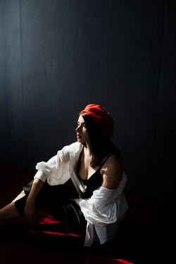 Marta Syrko GIRL WITH RED BERET SITTING IN SHADOW INDOORS Women