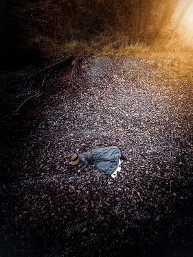 Mary Wethey WOMAN IN BONNET LYING IN WINTRY COUNTRYSIDE Women