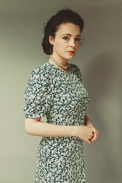 Shelley Richmond BRUNETTE WOMAN IN FLORAL DRESS AND PEARLS Women
