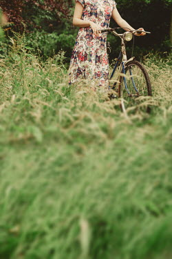 Shelley Richmond GIRL IN FLORAL DRESS WITH BICYCLE IN COUNTRYSIDE Women