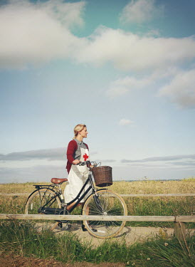 Mark Owen NURSE PUSHING BICYCLE ON COUNTRY PATH Women